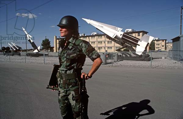 Military Policewoman In Front Of Nike Missiles, Fort Bliss, United States Army, Texas, USA, 1983 (photo)