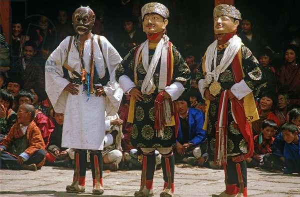 Mask dancers at the Paro Tshechu, mask dance festival, in the Paro Dzong, Bhutan (photo)