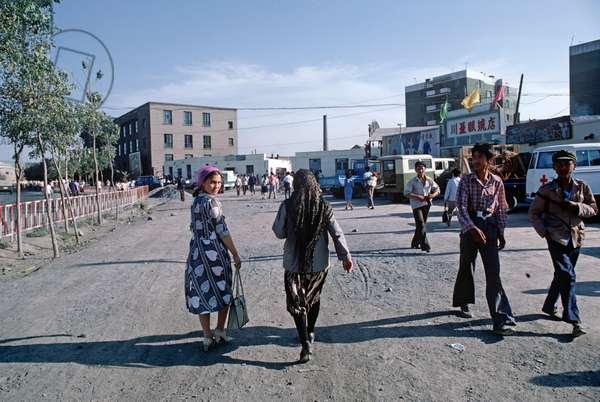 Uyghur women in Urumqi street, Xinjiang Province, China, 1985 (photo)