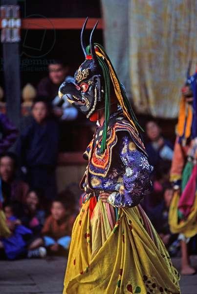 Animal mask dancer at the Paro Tshechu, mask dance festival, in the Paro Dzong, Bhutan (photo)
