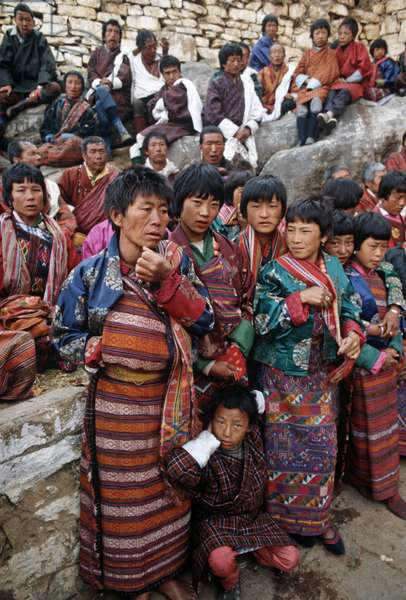 Bhutanese families at the Paro Tshechu, mask dance festival, in the Paro Dzong, Bhutan (photo)