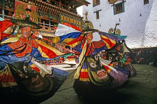 Black Hat dancers at the Paro Tshechu, mask dance festival, in the Paro Dzong, Bhutan (photo)