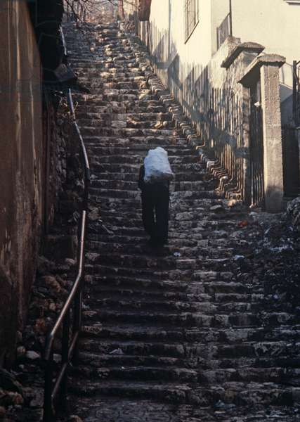Delivery of coal up steep steps in old part of Sarajevo, former Yugoslavia