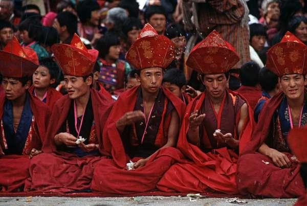 Buddhist monks at the Paro Tshechu, mask dance festival, in the Paro Dzong, Bhutan (photo)