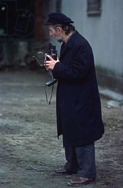 Photographer with Rolliflex camera in Grimaud Village, Cote D'Azur, France (photo)