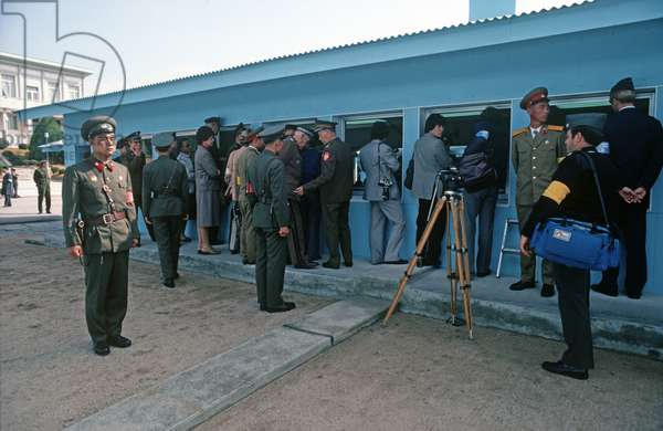 North Korean soldier with press and United Nations observers during talks between North and South Korea, Panmunjom, Korean Demilitarized Zone, DMZ Line (photo)