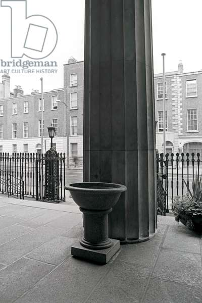 Bapbtismal font at St Andrews Church, Westland Row, Dublin, referred to as All Hallows Church by James Joyce in 'Ulysses', Dublin, Ireland (photo)