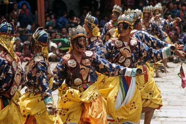 Bell dancers at the Paro Tshechu, mask dance festival, in the Paro Dzong, Bhutan (photo)