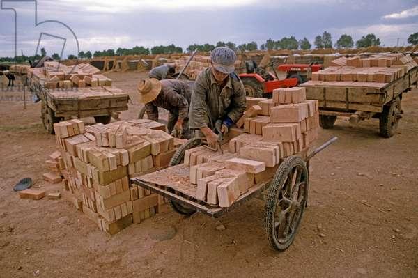 Hand made bricks, brick factory, Inner Mongolia, China, 1985 (photo)