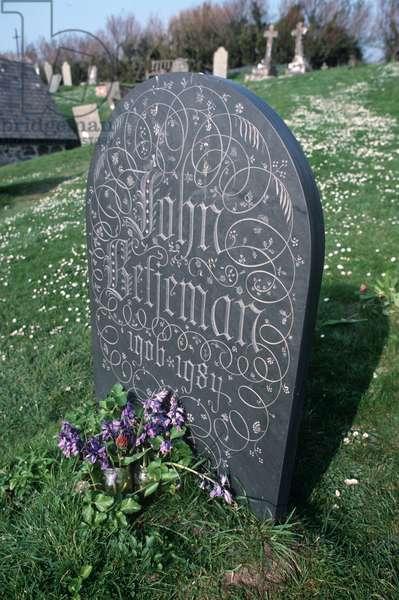 Poet Laureate John Betjeman ornate gravestone in St Enedoc's church, Trebetherick, Cornwall, UK (photo)
