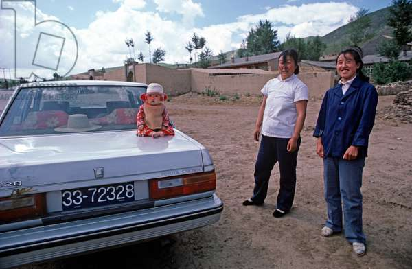 Baby photographed on car boot, Inner Mongolia, Northern China, 1985 (photo)
