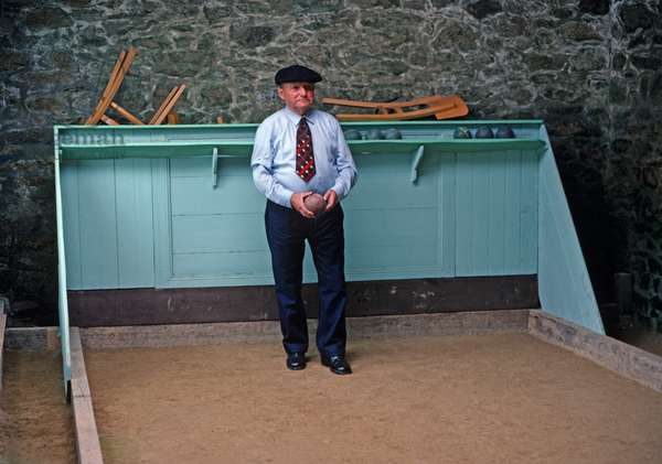 Boule players in indoor Boule court, village of Lampaul, Island of Ushant, Brittany, France (photo)