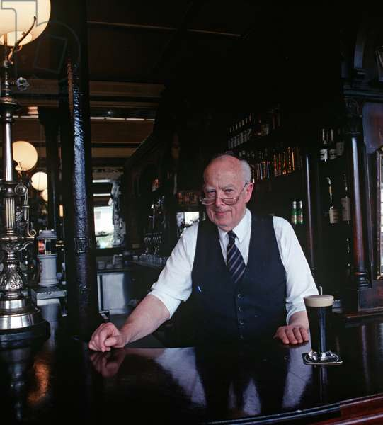 Barman in Ryan's Bar of Parkgate, Dublin, one of the few pubs which James Joyce was barred from, Ireland (photo)