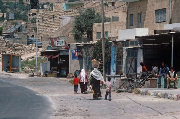 Palestinian family walking on road in West Bank, East Jerusalem, Israeli, Palestinian Authority (photo)