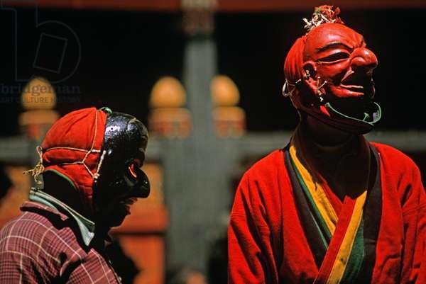 Mask actors at the Paro Tshechu, mask dance festival, in the Paro Dzong, Bhutan (photo)