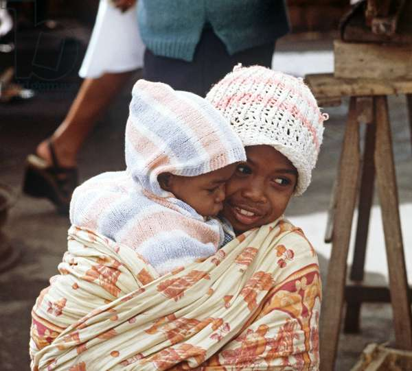 Girl and child in Antananarivo market, Madagascar, East Africa, Africa, 1980s (photo)