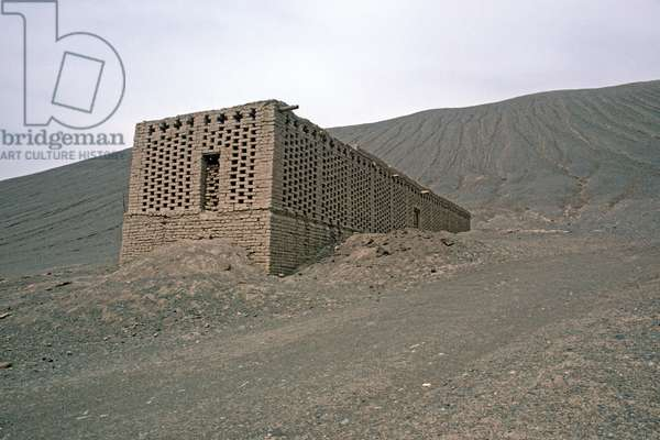 Grape storehouses made out of mud with gaps in bricks to air dry grapes in wine growing area around Turpan, Xinjiang Province, China, 1985 (photo)