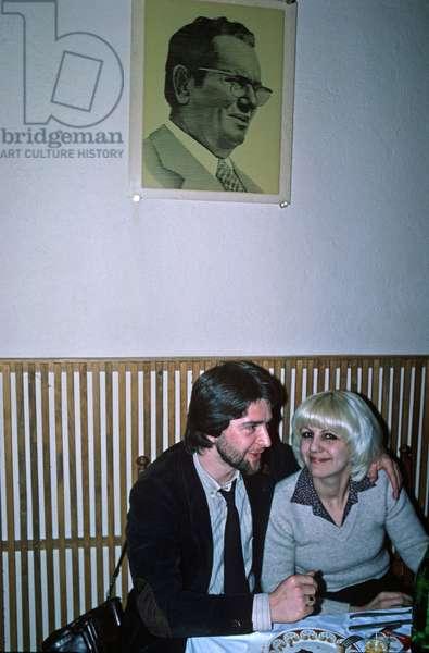 Portrait of Tito above couple in Sarajevo restaurant, former Yugoslavia