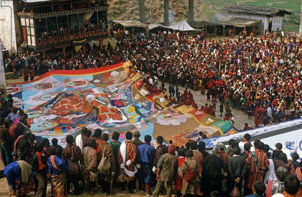 Folding of the Thangka, a large tapestry, at the Paro Festival during the religious ceremony, Bhutan (photo)