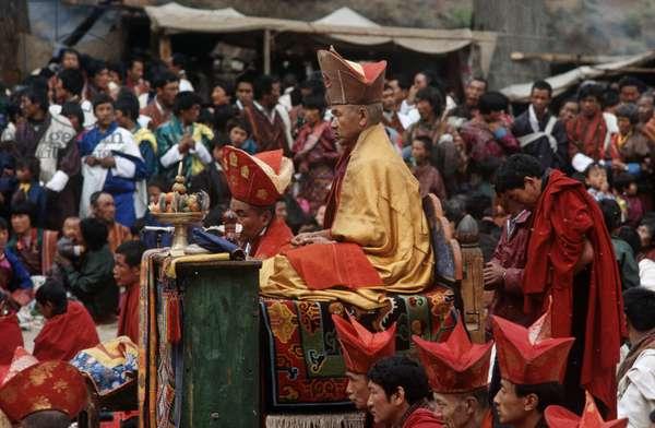 Buddhist Abbot monk at the Paro Tshechu, mask dance festival, in the Paro Dzong, Bhutan (photo)