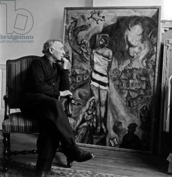 Painter Marc Chagall in his New York apartment painting The Martyr (1940) (b/w photo)