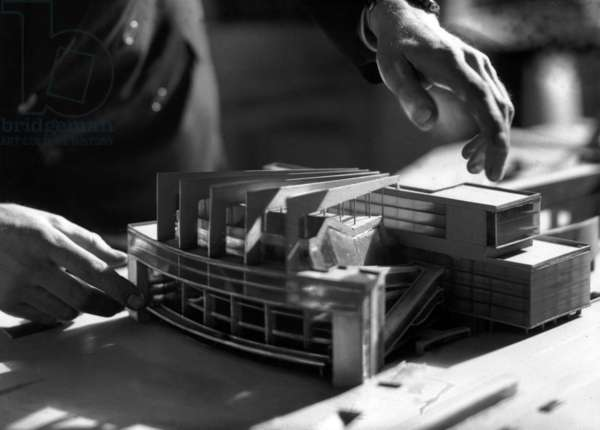 French architect Le Corbusier (1887-1965) with scale model of Soviet Palace in Moscow (1930)