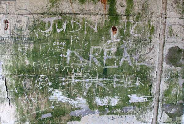Graffiti on a Nazi bunker, Omaha Beach, France (photo)