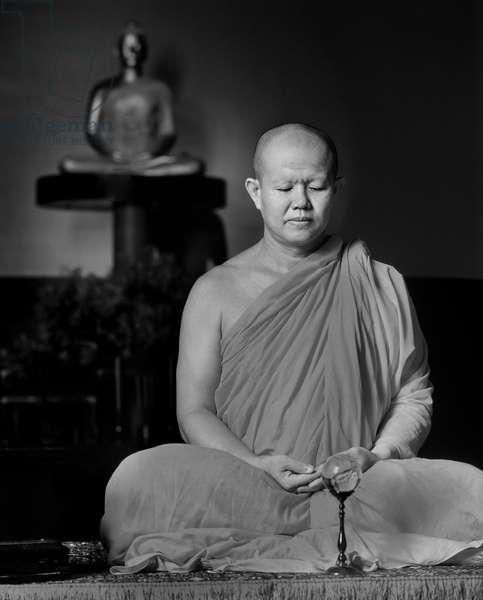 Monk meditating (b/w photo)