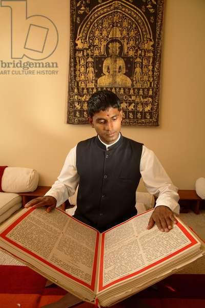 Man reading the Vedic texts (photo)