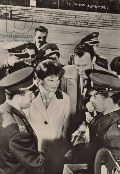 Valentina Tereshkova-Nikolayeva and Yuri Gagarin were heartily welcomed when they visited the frontier guards in Berlin on 20 October 1963 (b/w photo)