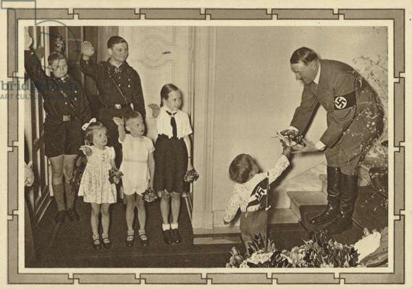 Child giving a bunch of flowers to Adolf Hitler (b/w photo)