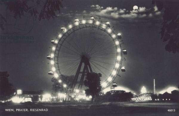 Postcard depicting a ferris wheel (b/w photo)