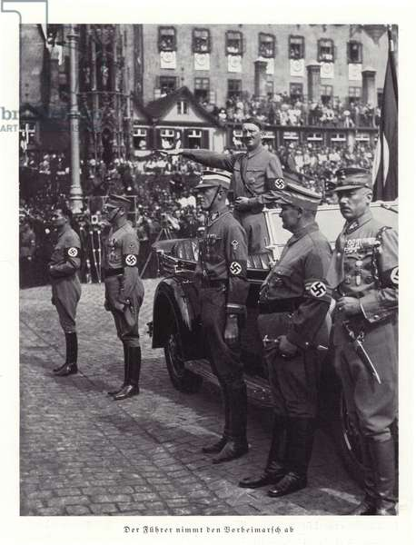 Hitler reviewing a march past; Nuremberg Rally, 1936 (b/w photo)