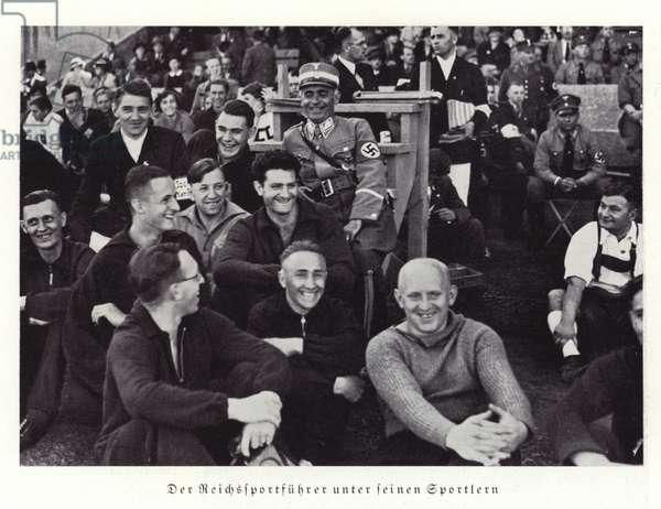 Reichssportfuhrer Hans von Tschammer und Osten surrounded by athletes, Nuremberg Rally, 1936 (b/w photo)