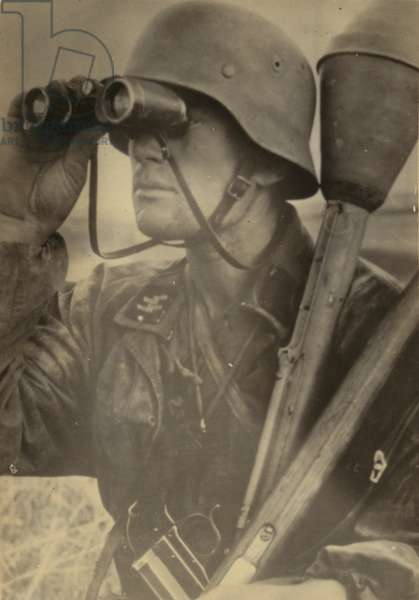German SS soldier with Panzerfaust 30 klein and Leuchtpistole (b/w photo)