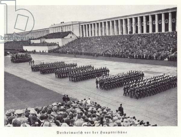 Nazi workers marching past the grandstand, Nuremberg Rally, 1936 (b/w photo)