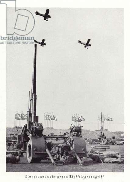 Display of anti-aircraft guns and aeroplanes, Nuremberg Rally, 1936 (b/w photo)