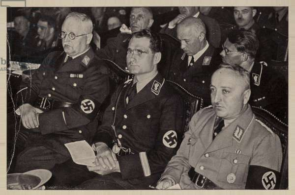 German Nazi deputy leader Rudolf Hess (centre) and Georg Ahlemann (lighter uniform) at a meeting, 1930s (b/w photo)
