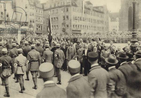 Adolf Hitler at a Nazi rally in Nuremberg on German Day, 1923 (b/w photo)