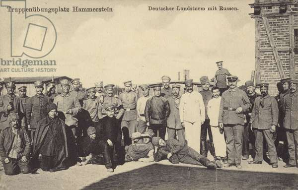 German Landsturm militia soldiers with Russian prisoners of war on the military parade ground in Hammerstein, Germany, World War I, 1914-1918 (b/w photo)
