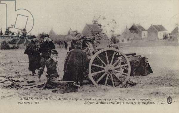 Belgian artillery receiving a message by field telephone, World War I, 1914-1915 (b/w photo)