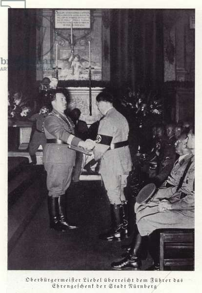 The Mayor of Nuremberg presenting Adolf Hitler with a gift from the city, 1936 (b/w photo)