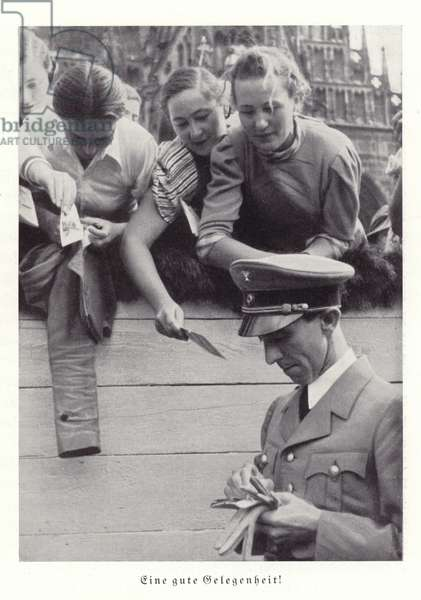 Joseph Goebbels signing autographs for Nazi supporters, Nuremberg, 1936 (b/w photo)