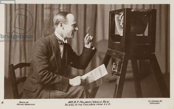 Rex Palmer (Uncle Rex), broadcasting to children on BBC radio (b/w photo)