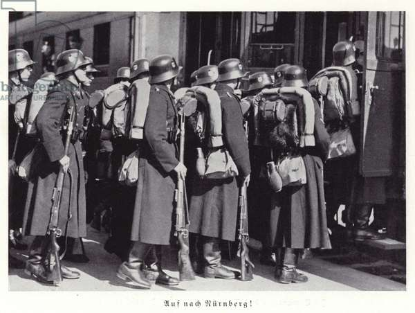 German soldiers boarding a train for Nuremberg, 1936 (b/w photo)