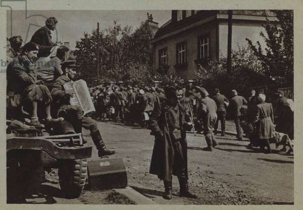 Russian soldiers watching a passing column of refugees, Eastern Europe, World War II (b/w photo)