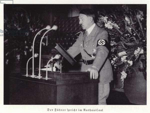 Adolf Hitler making a speech in Nuremberg City Hall, 1936 (b/w photo)