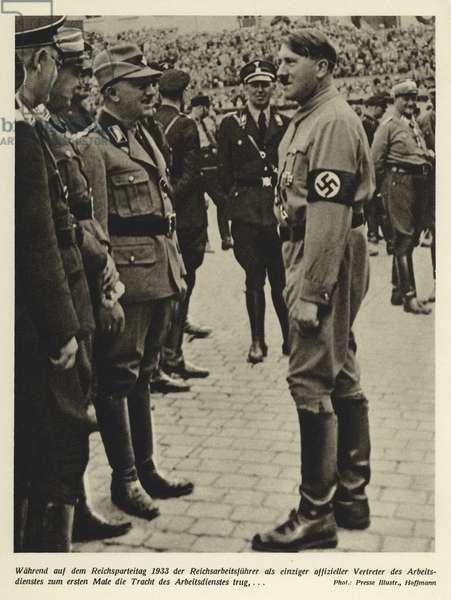 Adolf Hitler and Konstantin Hierl, commander of the Reichsarbeitsdienst (Reich Labour Service) at the Nuremberg Rally, 1933. (b/w photo)