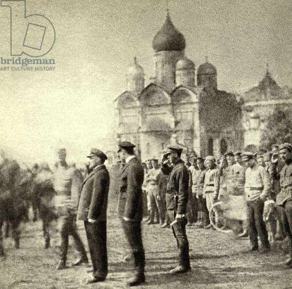 Lenin reviews the 11th group of graduates of the First Moscow Soviet Machine-Gun Commander School in the Kremlin, Moscow, 12 May 1920 (b/w photo)