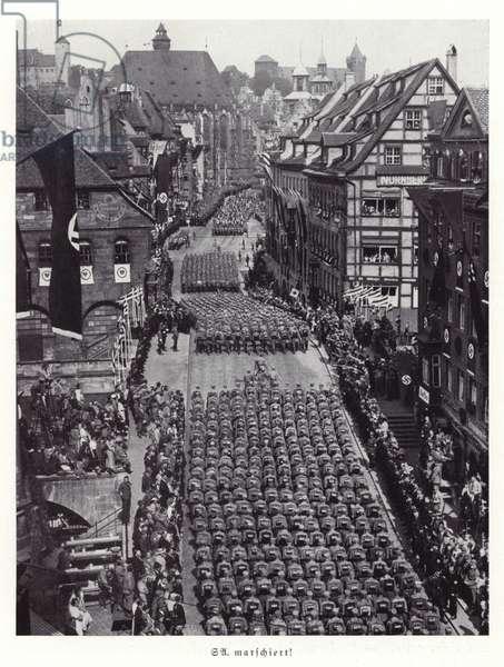 Members of the SA marching through Nuremberg, 1936 (b/w photo)